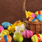 Many painted easter eggs with easter basket
